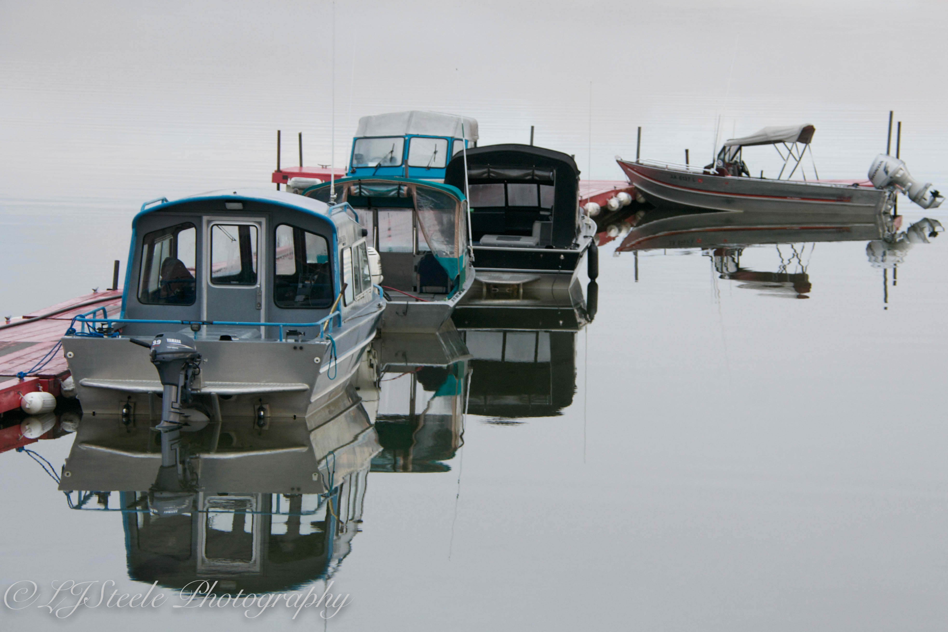Boats in the morning stillness ~ Lake Louise, Alaska